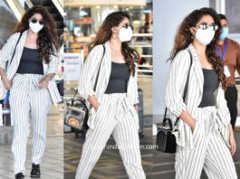 keerthy suresh stylish airport look black and white suit