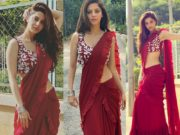 Actress vedhika in a maroon pleated saree