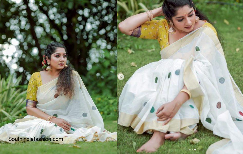 Anumol in a white traditional kerala saree