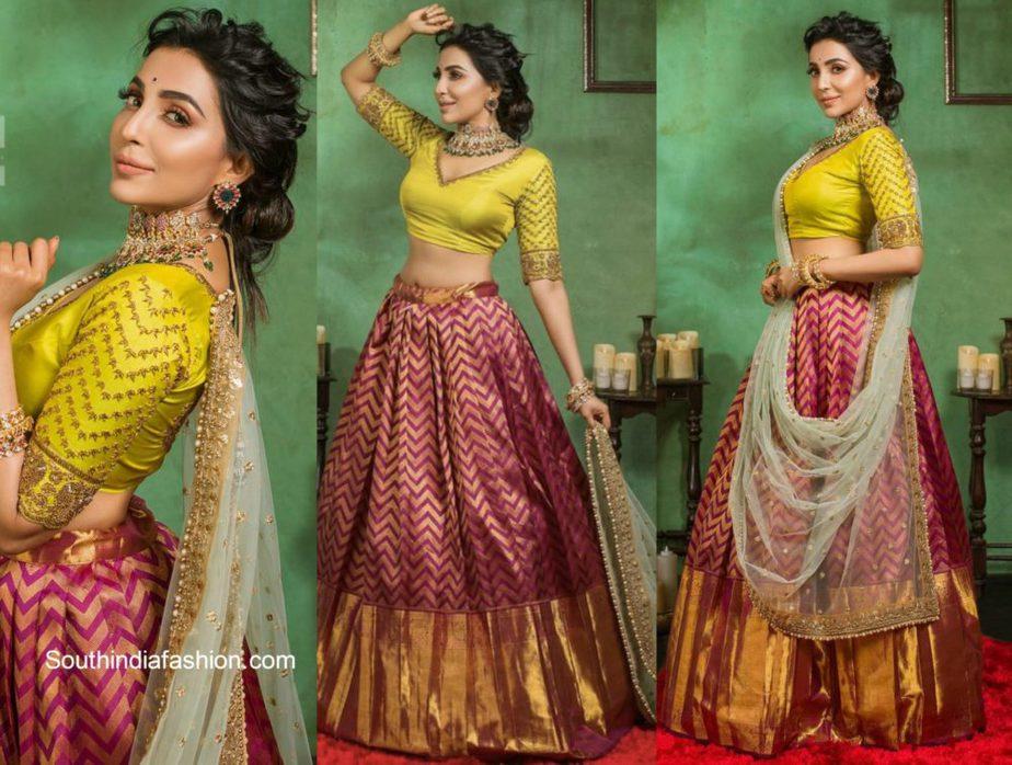 Parvati Nair in red silk lehenga with yellow blouse