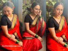 amruta khanvilkar in red traditional saree