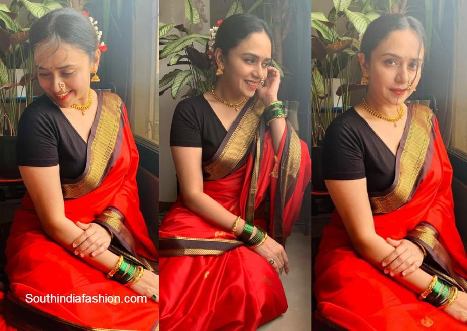 amruta khanvilkar in red traditional saree