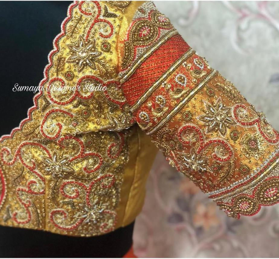 gold color embroidered silk saree blouse