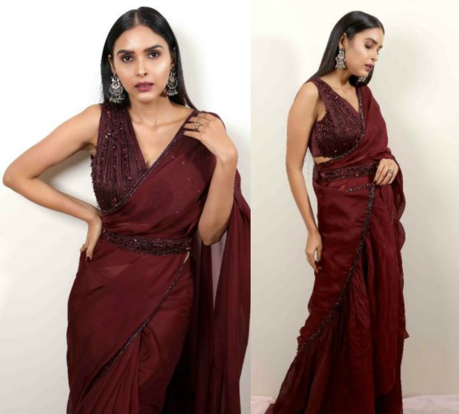 saree in wine colour and embroidered sleeveless blouse
