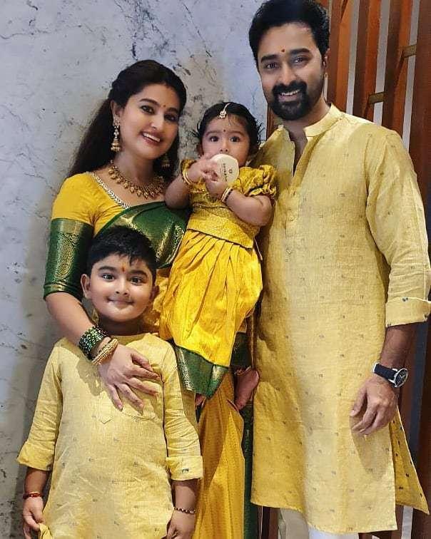 Sneha prasanna in yellow saree by muhurth and prasanna in gold kurta for diwali 2