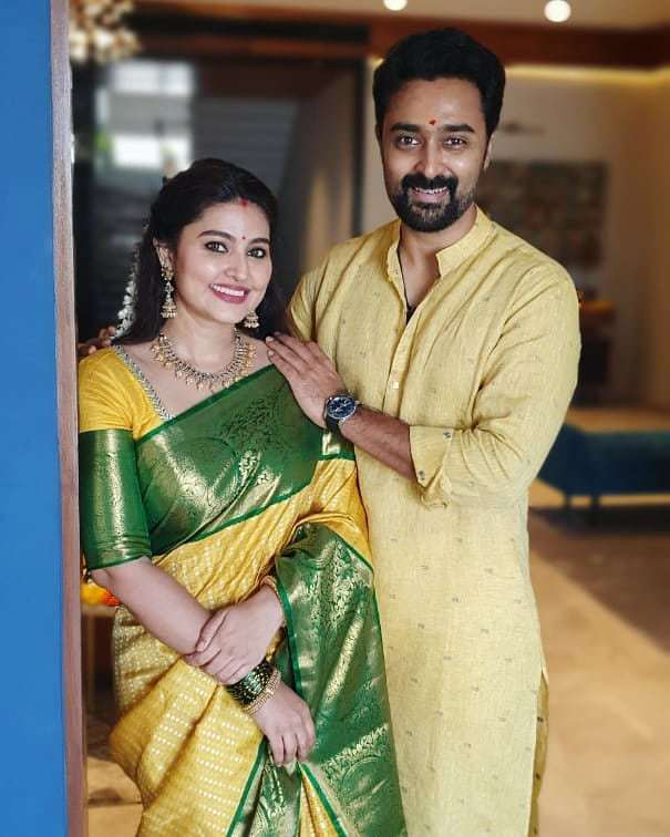 Actress Sneha And Prasanna Pose For A Family Photo In Ethnics For Diwali