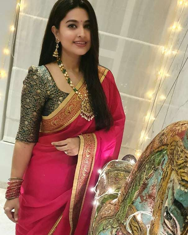 Actress Sneha in a red saree and balck blouse by geethu haut couture2