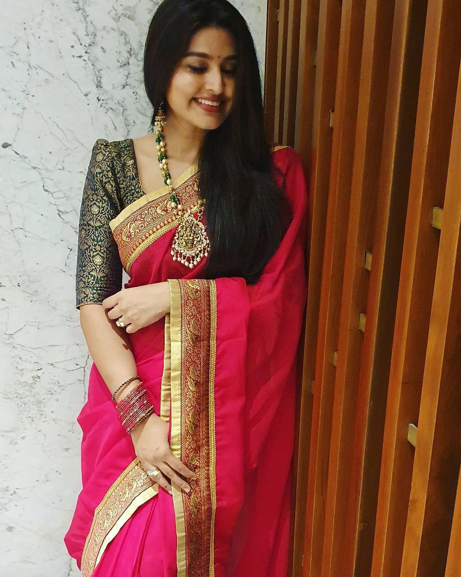 Actress Sneha in a red saree and balck blouse by geethu haut couture1