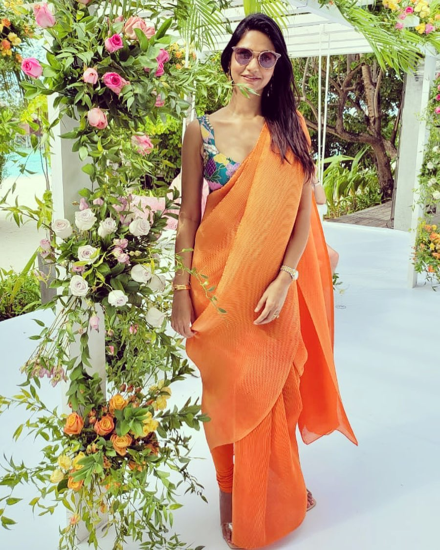 Sneha reddy in an orange pant saree by aisha Rao for a wedding in Maldives