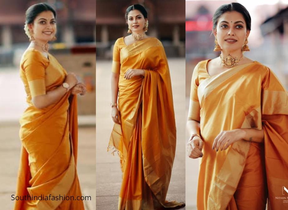 Actress Anusree in golden orange pattu saree in guruvayur
