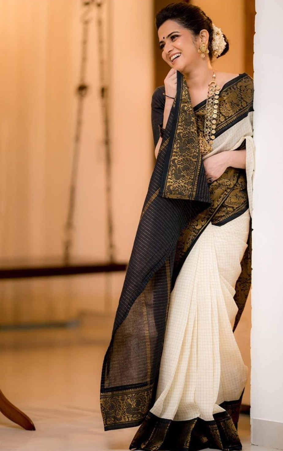 Dhivyadharshini in black and white saree by virupa