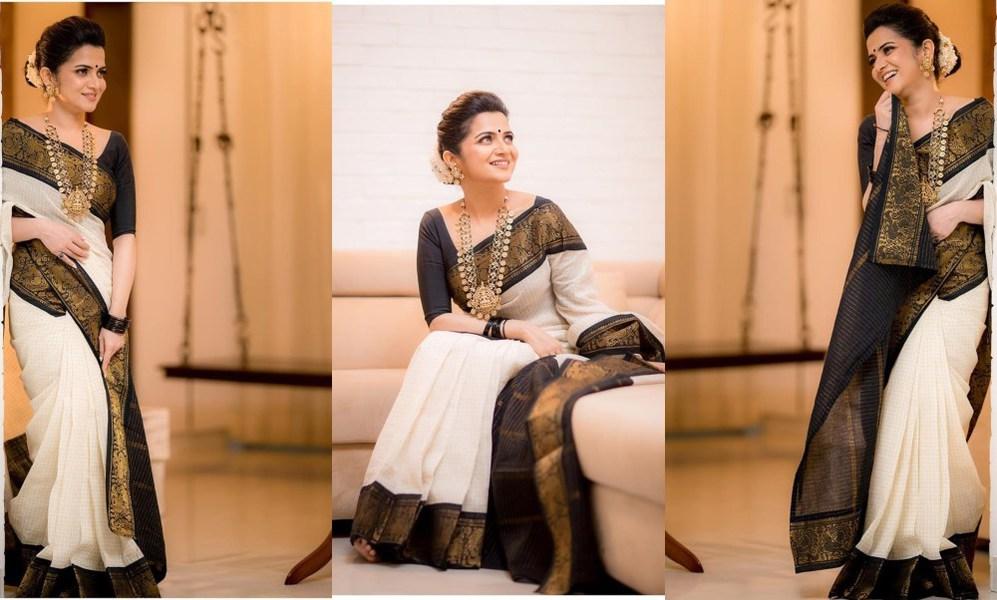 Dhivyadharshini in black and white saree by virupa