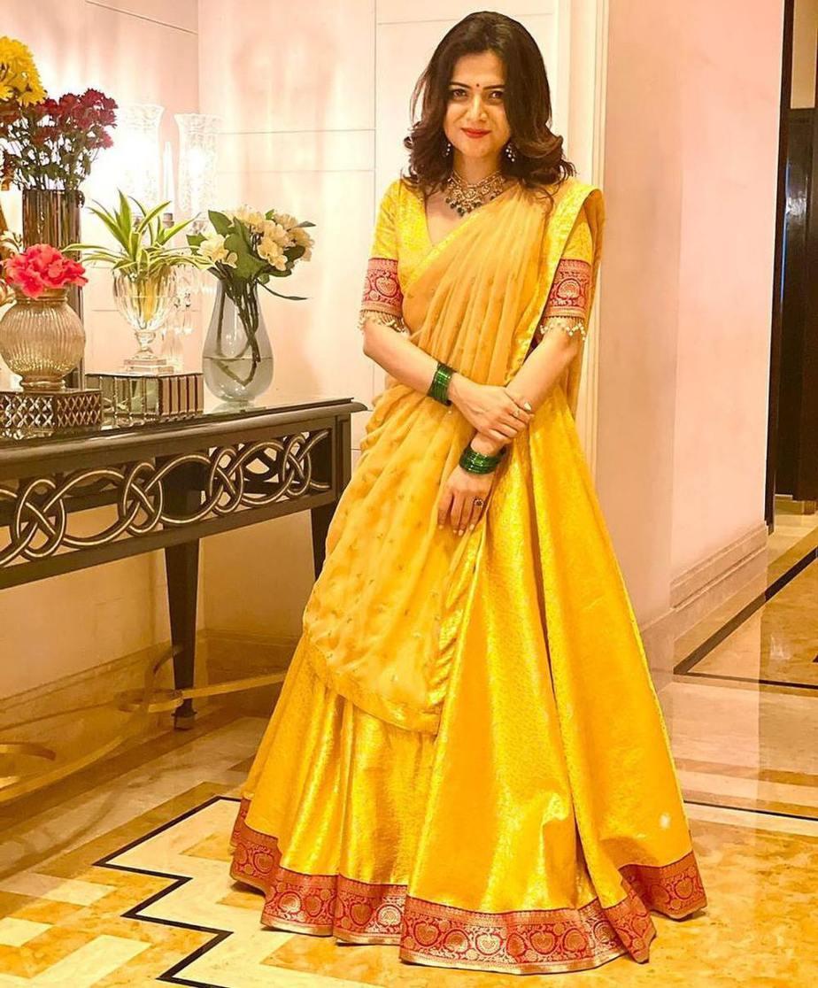 Dhivyadharshini in yellow lehenga by Suresh Menon