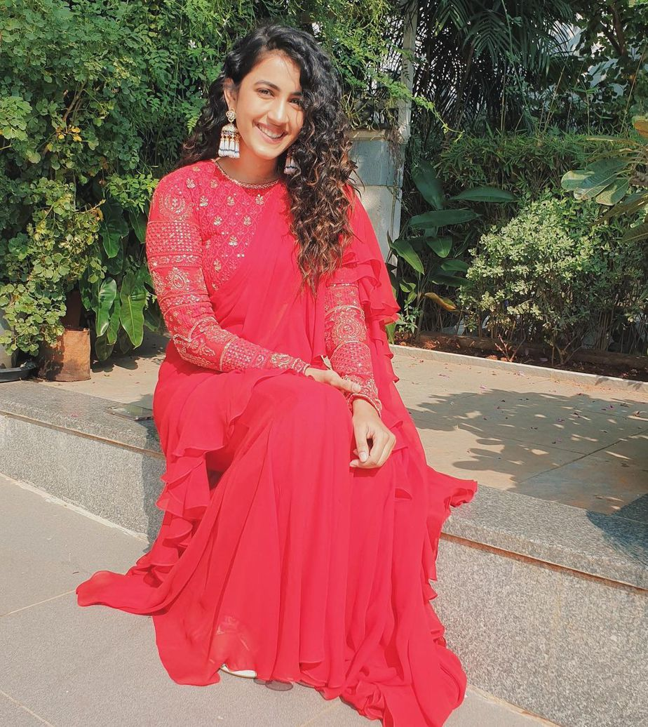 Niharika konindela in a red ruffle saree