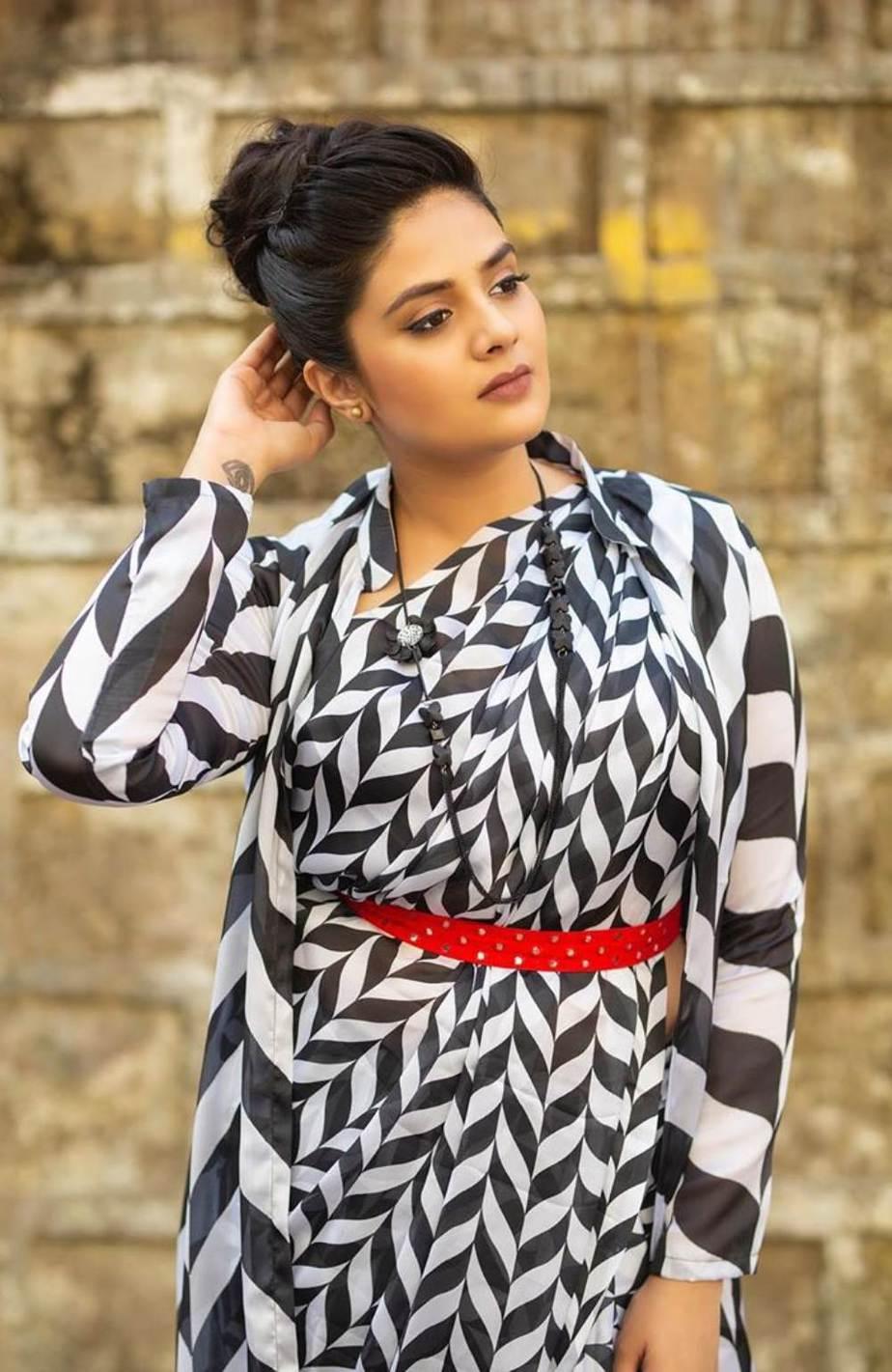 Sreemukhi in Rekha's couture saree