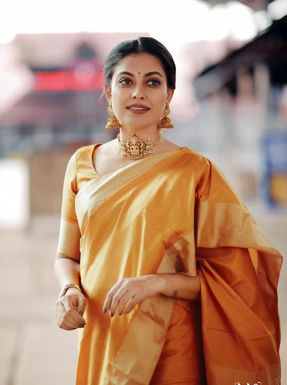 anusree in orange gold saree in guruvayur