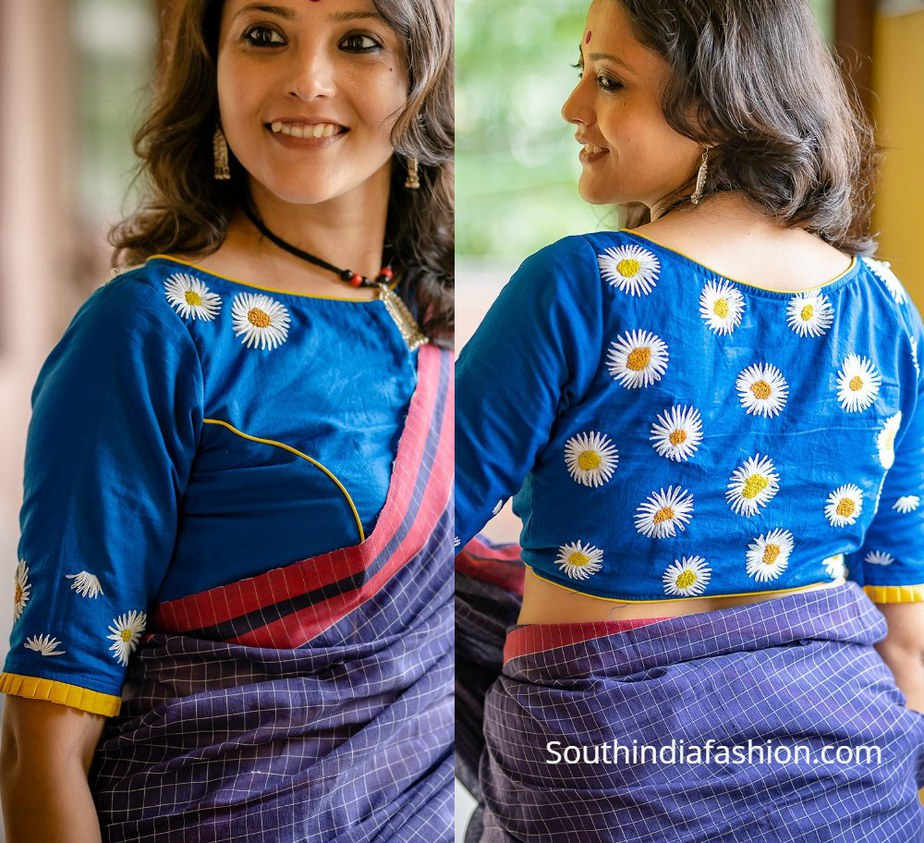 blue blouse with white daisy flower design