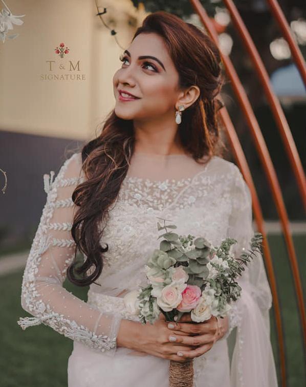 madonna sebastian in t&m white bridal saree