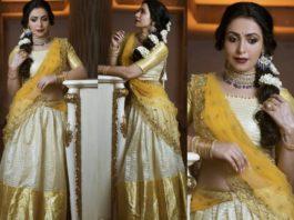 nandini rai in traditional off-white half saree
