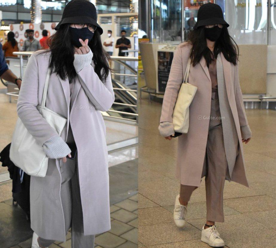 rashmika mandanna airport look in a long overcoat sweater