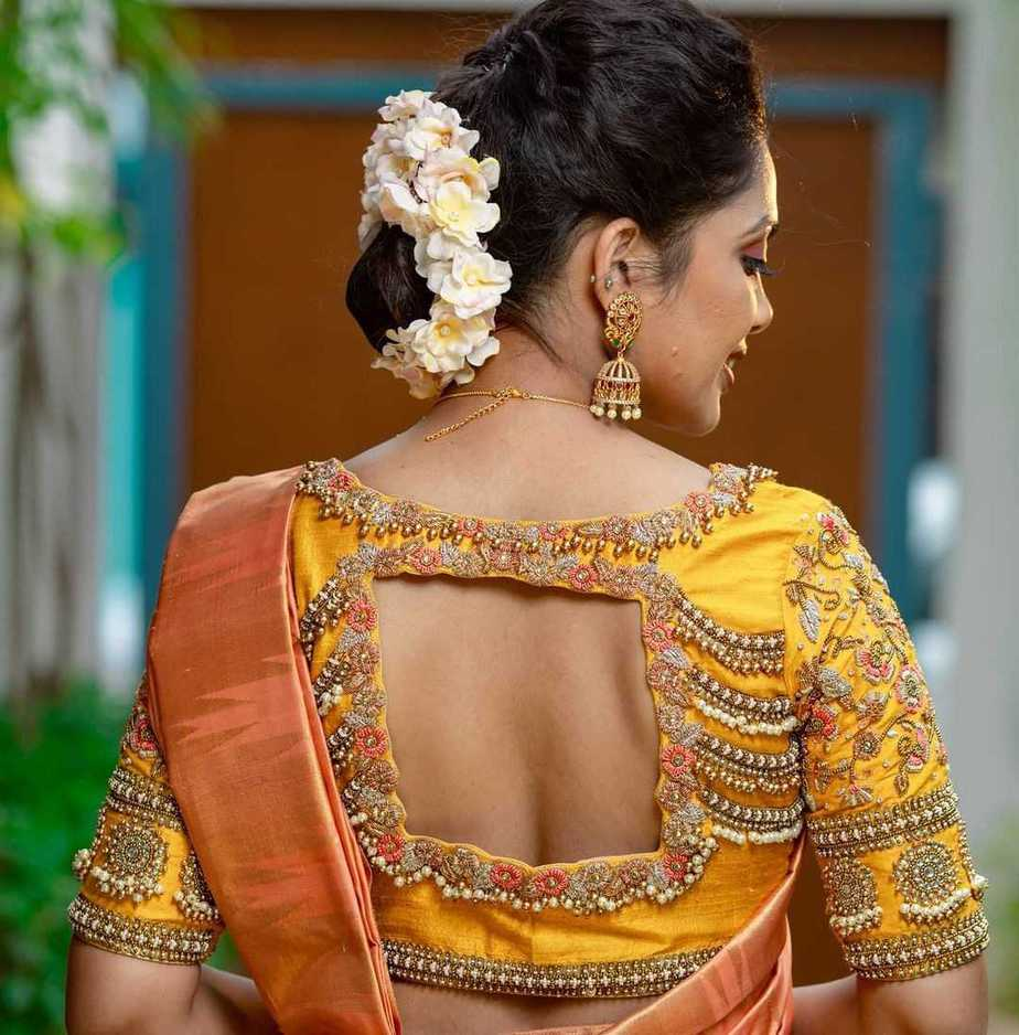 yellow bridal blouse with pearl work by sruthi kannath