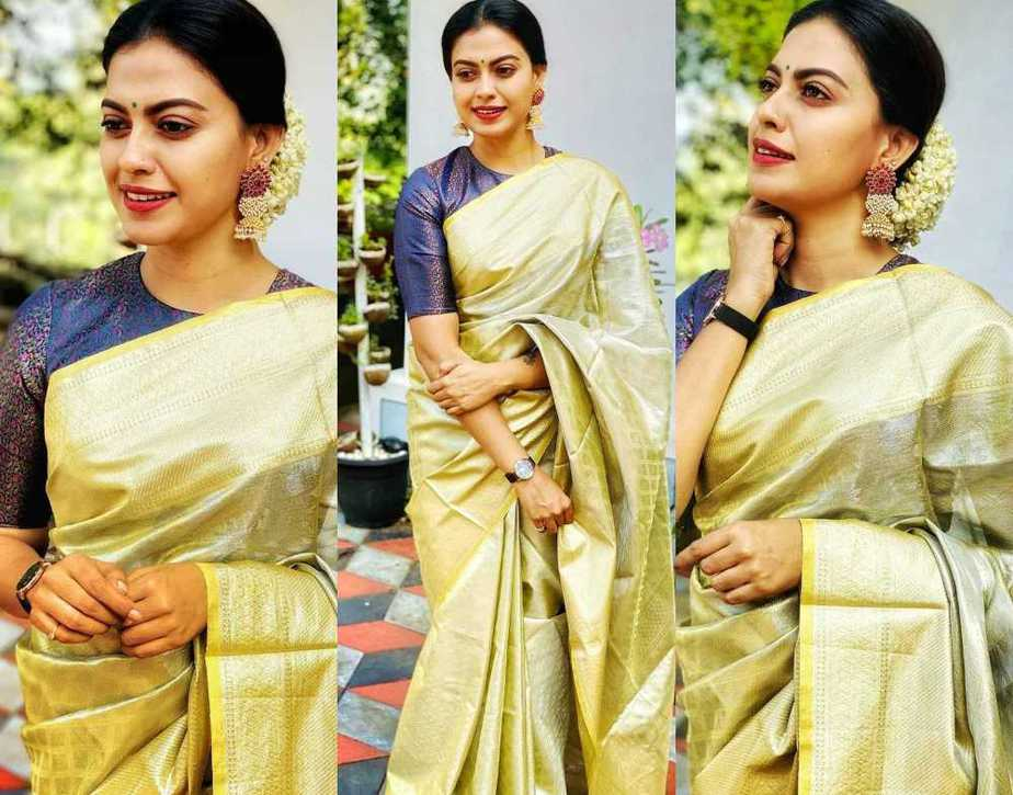Anusree in a green pattu saree featured