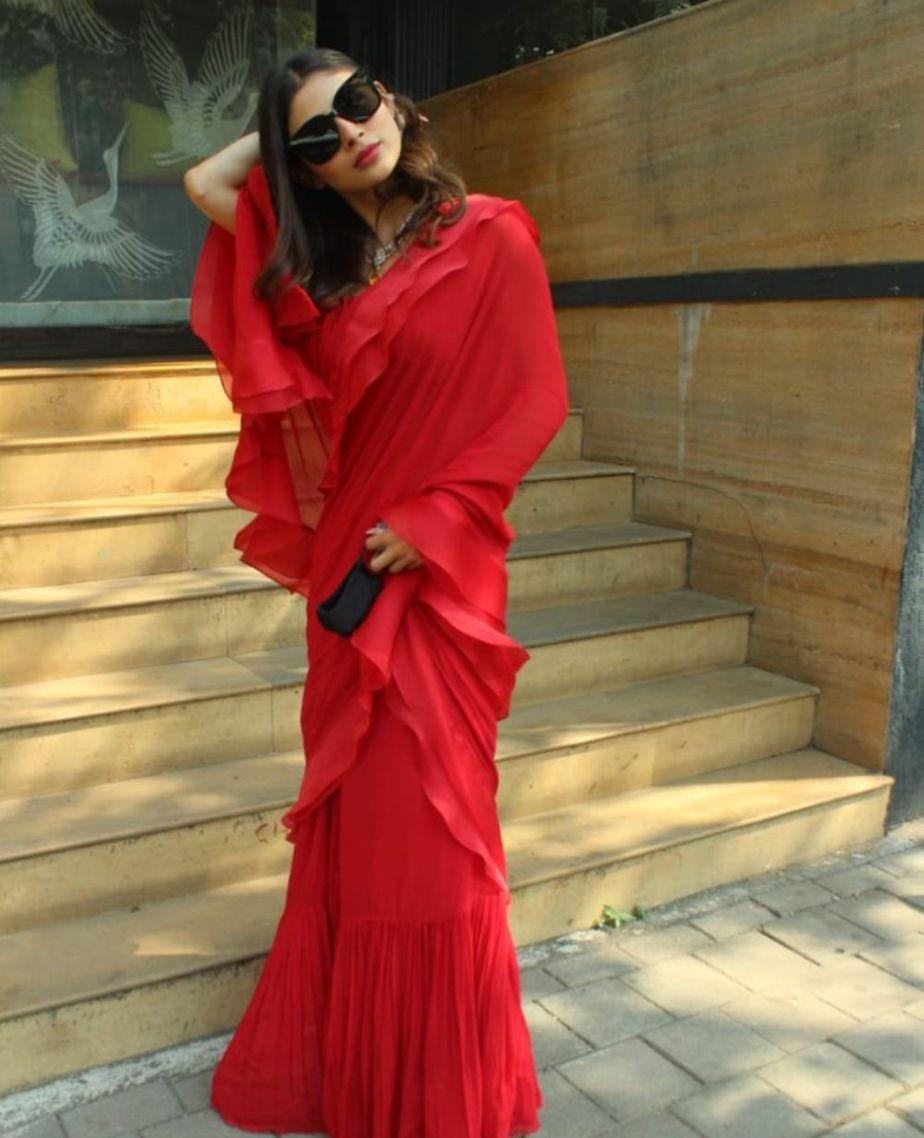 Mouni Roy snapped in Juhu wearing a red ruffle saree