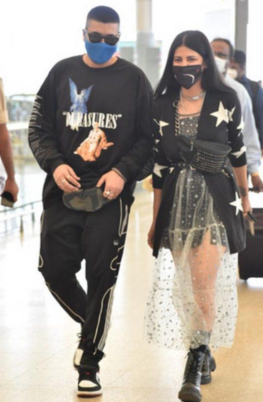 Shruti Haasan at airport in dress and cardigan looking gothic!