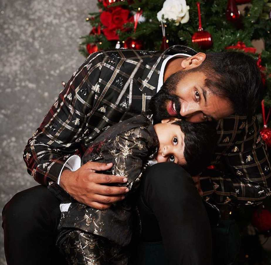 Vishnu Manchu and family in black outfits by maison ava for christmas'20