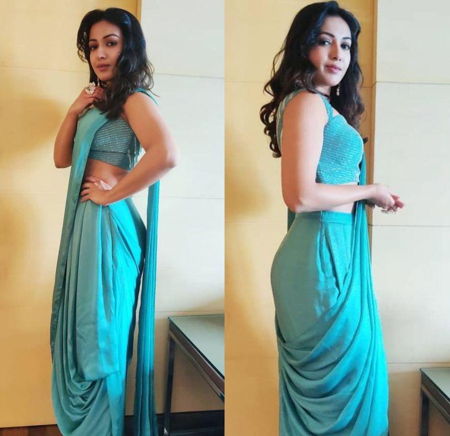 catherine tresa in a blue dhoti saree