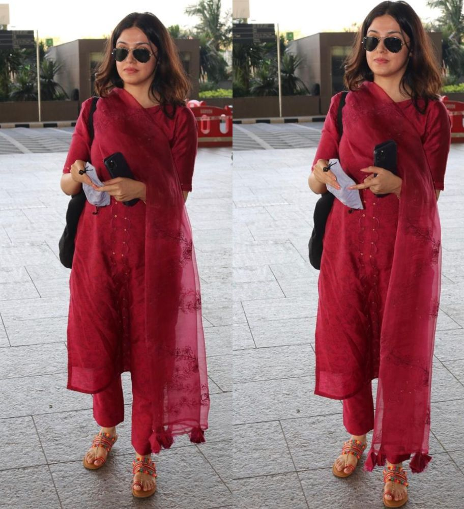 divya khosla kumar in red suit at the airport