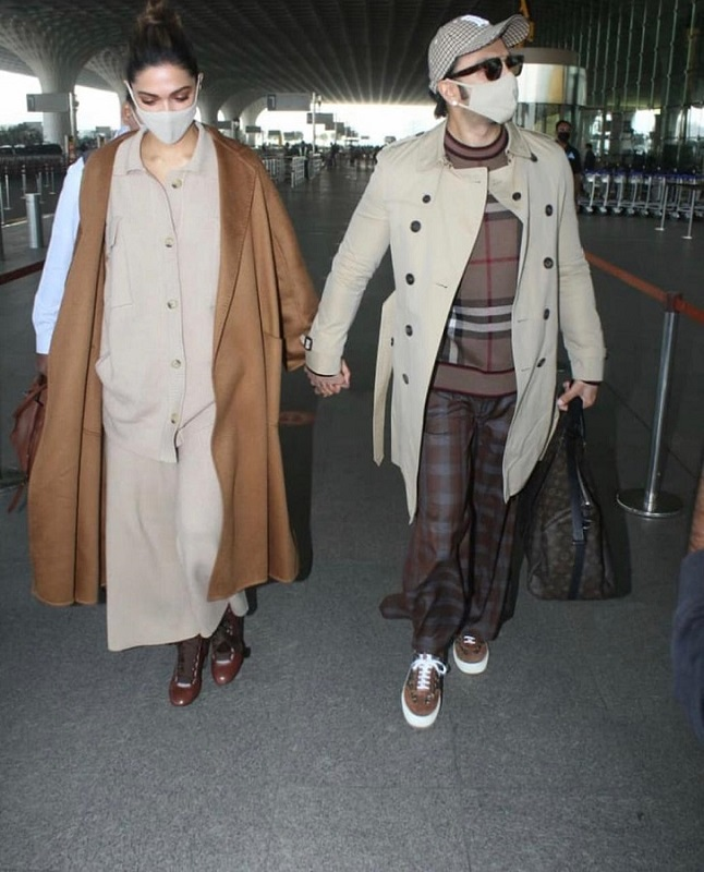 ranveer singh and deepika padukone spotted at the airport in color coordinated winter outfits.