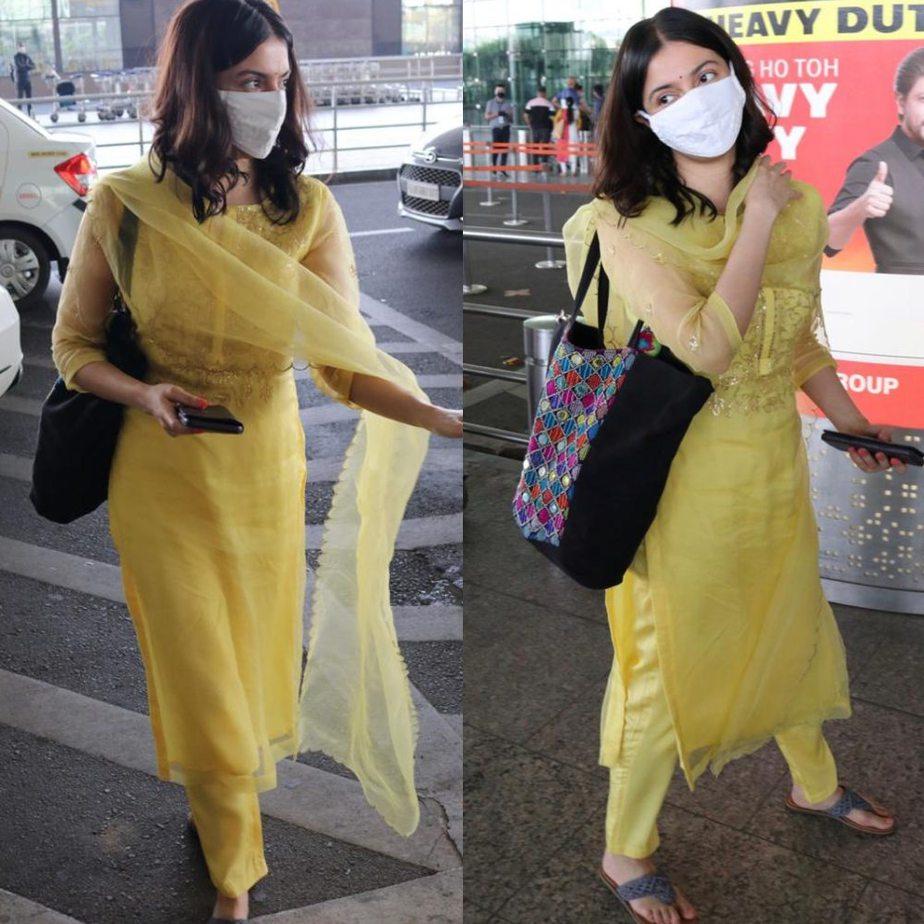 divya khosla kumar wearing a yellow outfit at airport