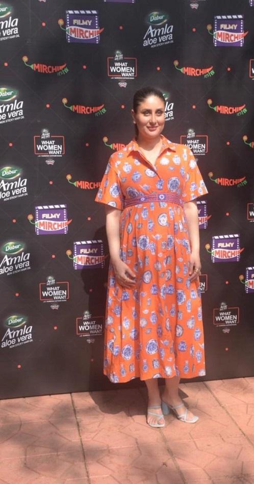 Kareena Kapoor Khan in a maternity orange printed maxi dress