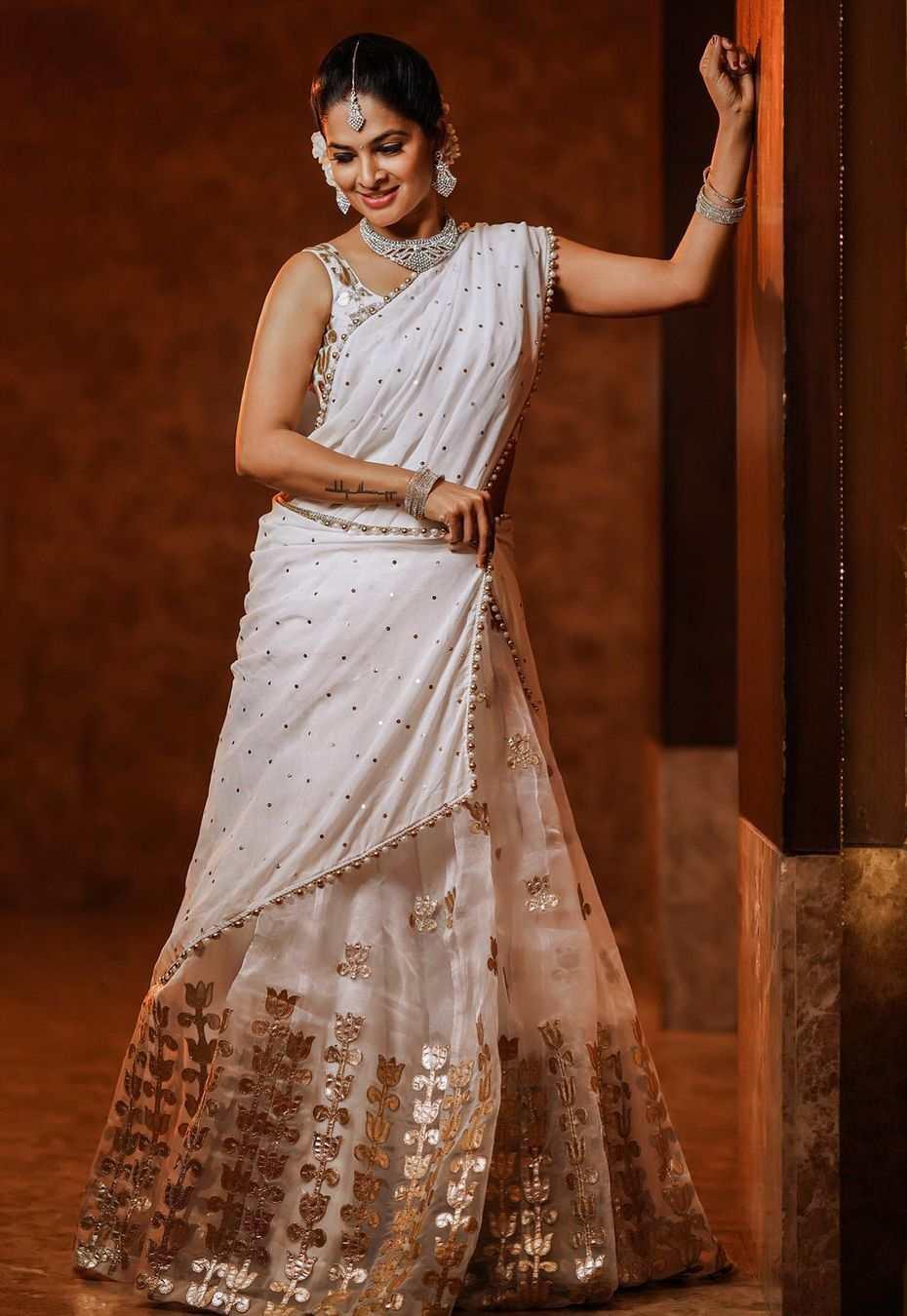 madhumita siva balaji in white gold half saree