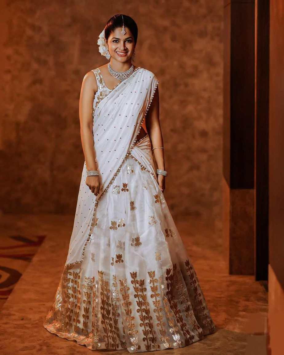 madhumita sivabalaji half saree in white and gold