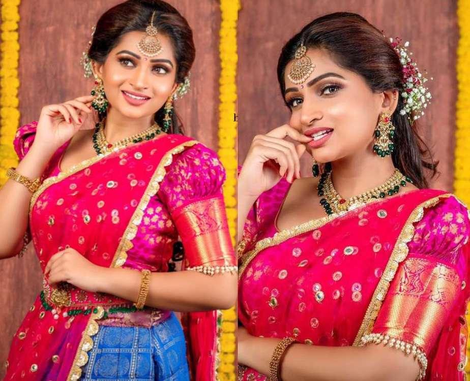 nakshathra nagesh in a pink blue half-saree lehenga look