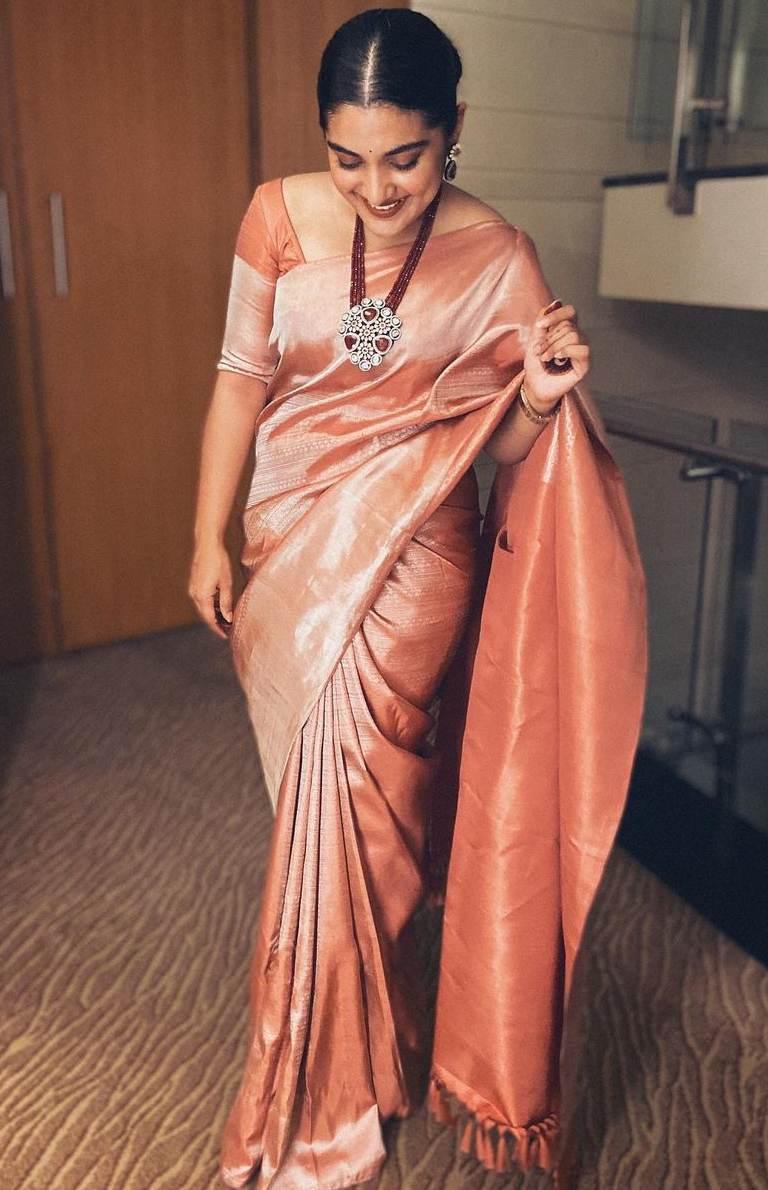 nivetha thomas pink silk saree at vivek athreya wedding