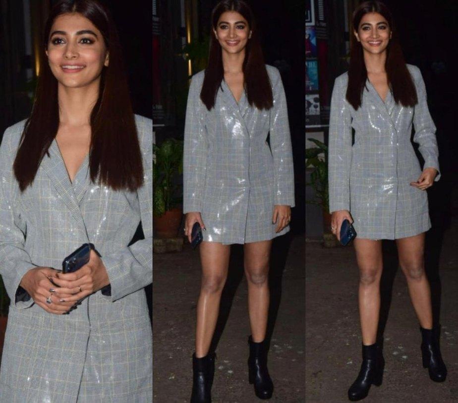 pooja hedge in a grey silver blazer dress.