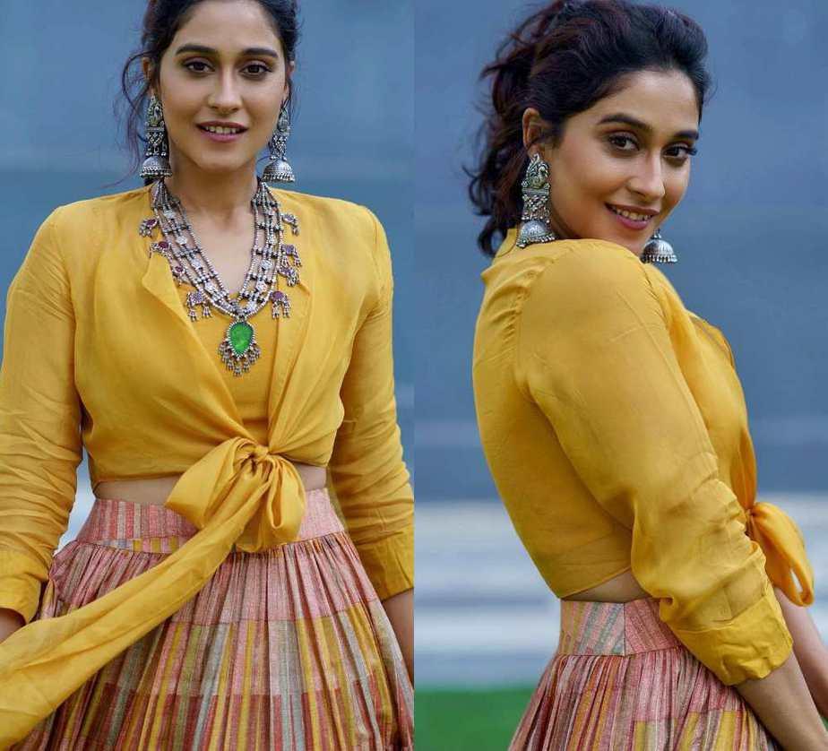 regina cassandra in a mustard yellow skirt from label anusree