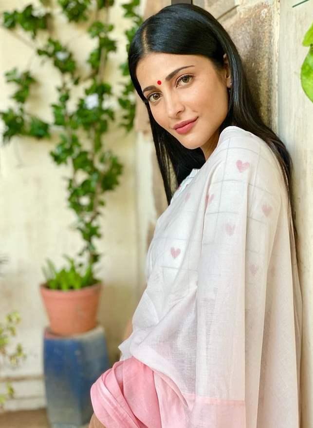 shruthi haasan white saree by kaluva