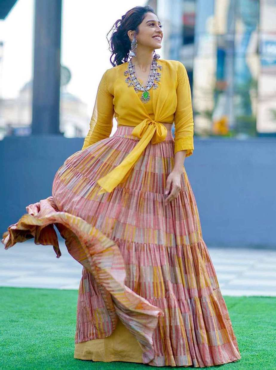 yellow flowing skirt with knotted shirt