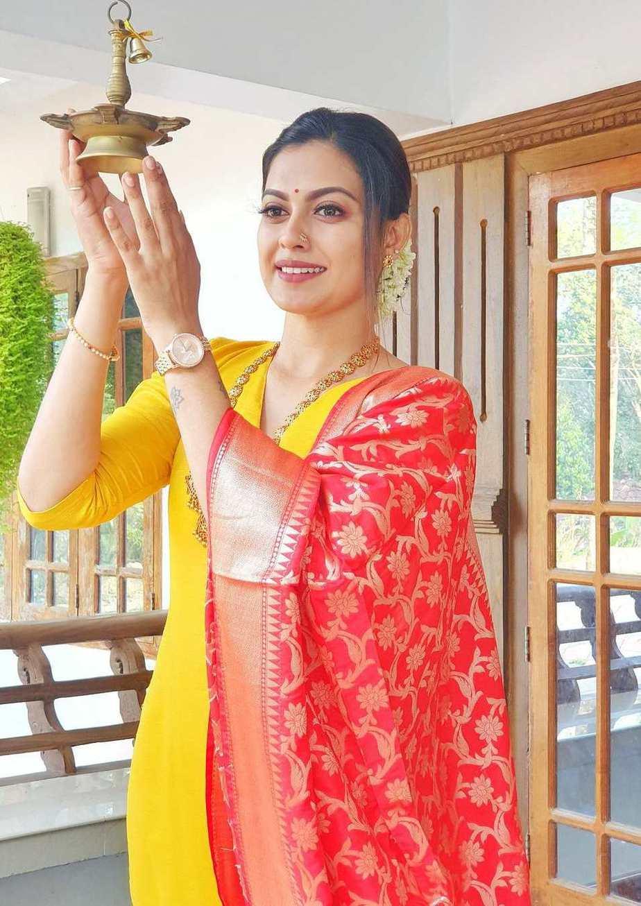 Anusree Nair in an yellow kurta set for cousin's wedding