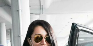 Trisha in long coat and denim at airport1