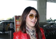 Hansika Motwani in a blue jeans-red jacket at Hyderabad airport4