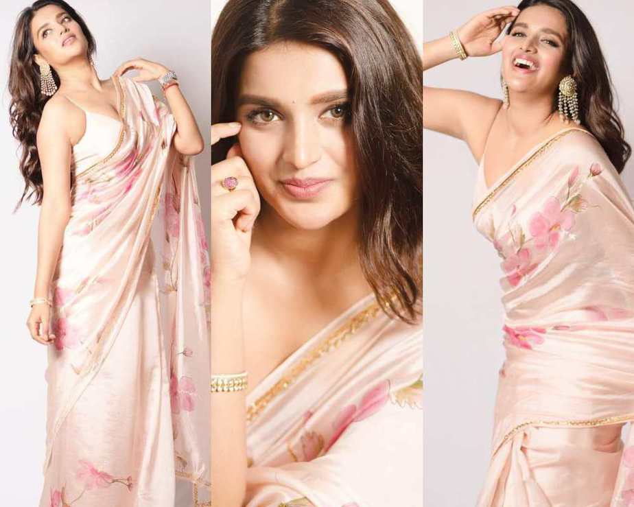 Niddhi agerwal in peach colour saree by picchika for eeswaran promotions-featured