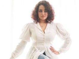 Nithya Menen in white top and ripped jeans