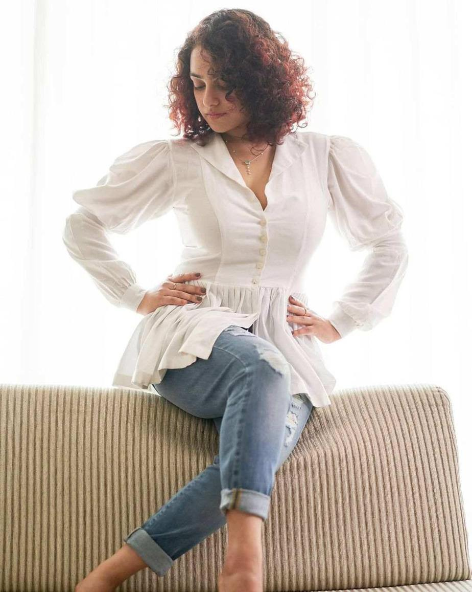 Nithya Menen in white top and ripped jeans1