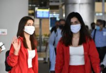 Raashi Khanna at airport in red jacket and joggers
