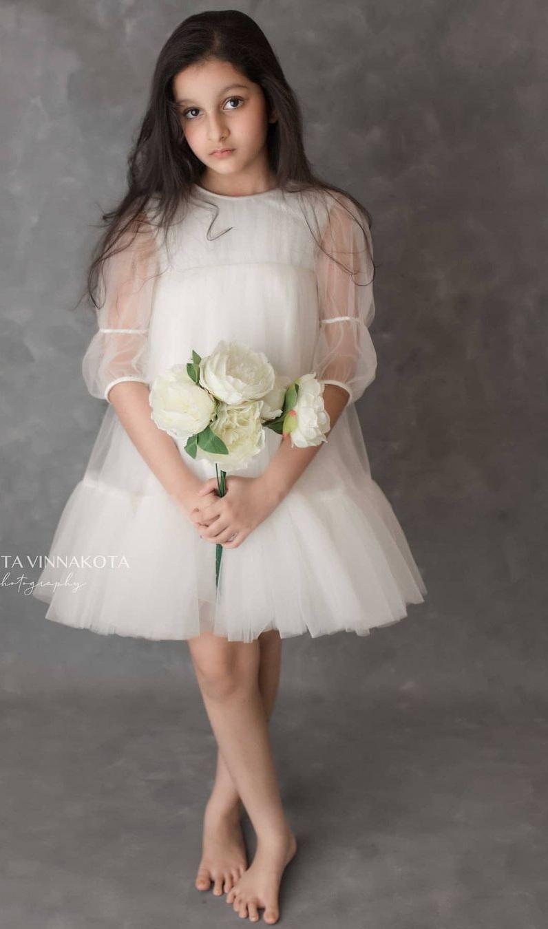 Sitara Ghattamaneni in a white dress by Janya's closet4